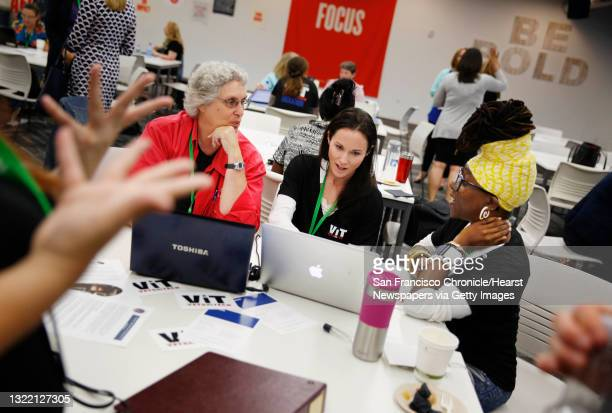 Diane Reppun of Los Gatos brainstorms her idea with Carly DaCosta of San Francisco and Ardrina Hoxey of Oakland during the first Women-VetsinTech...