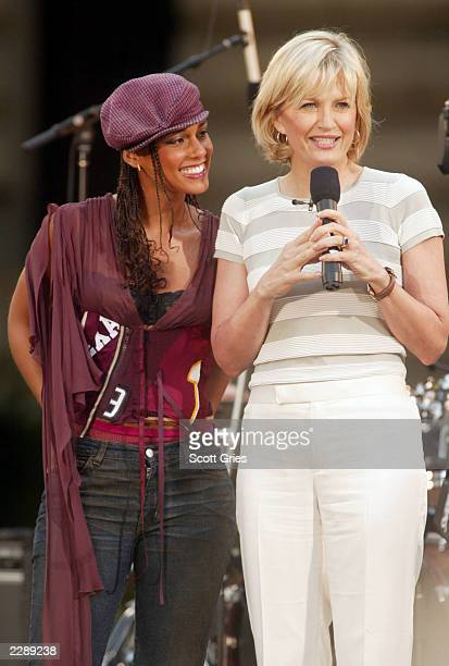 Diane Sawyer with Alicia Keys after her performance as part of the Summer Concert Series on ABC's Good Morning America in Bryant Park in New York...