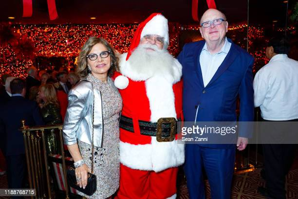 Diane Tuft Santa Claus and Tom Tuft attend Anne Hearst McInerney Jay McInerney And George Farias Host Christmas Cheer at Doubles Club on December 13...