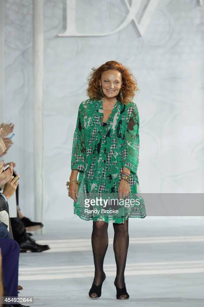 Diane von Furstenberg greets the audience after the Diane Von Furstenberg fashion show during MercedesBenz Fashion Week Spring 2015 at Spring Studios...