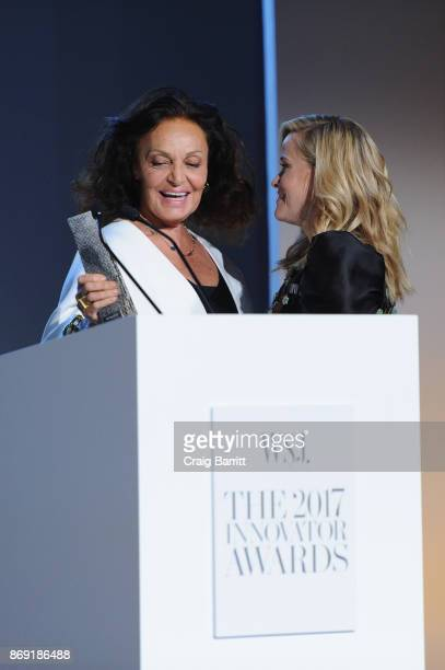 Diane Von Furstenberg presents an award onstage to Reese Witherspoon during the WSJ Magazine 2017 Innovator Awards at MOMA on November 1 2017 in New...