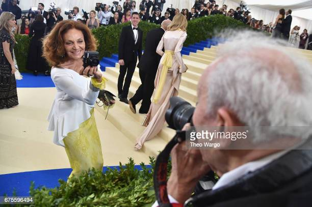 Diane Von Furstenberg takes a photo of photographer Ron Galella at the Rei Kawakubo/Comme des Garcons Art Of The InBetween Costume Institute Gala at...