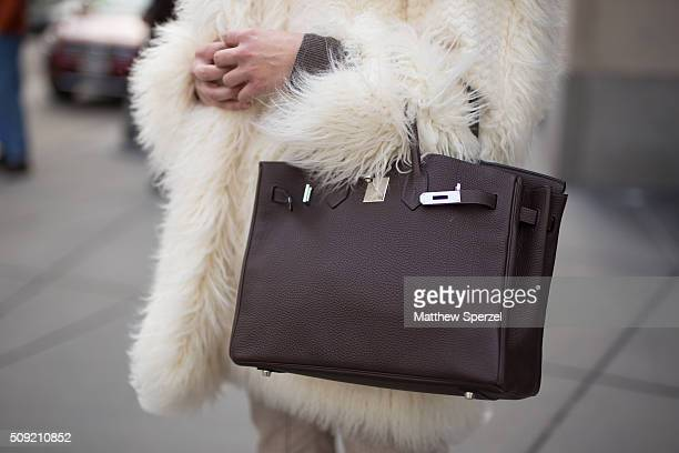 Diane Vukas is seen on Rush Street wearing a cream white ÔFur Free FurÕ Stella McCartney coat chocolate leather Hermes bag bone Brunello Cucinelli...