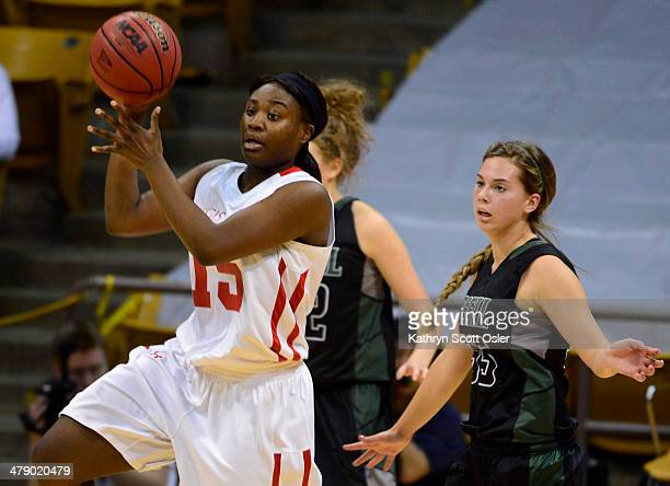 Diani Akigbogun jumps up for the pass for Regis Jesuit in the second half The Regis Jesuit Raiders take on the Fossil Ridge Sabercats in the Colorado...
