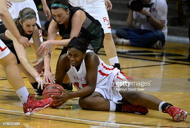Diani Akigbogun wrestles for control of the ball for Regis Jesuit in the second half The Regis Jesuit Raiders take on the Fossil Ridge Sabercats in...