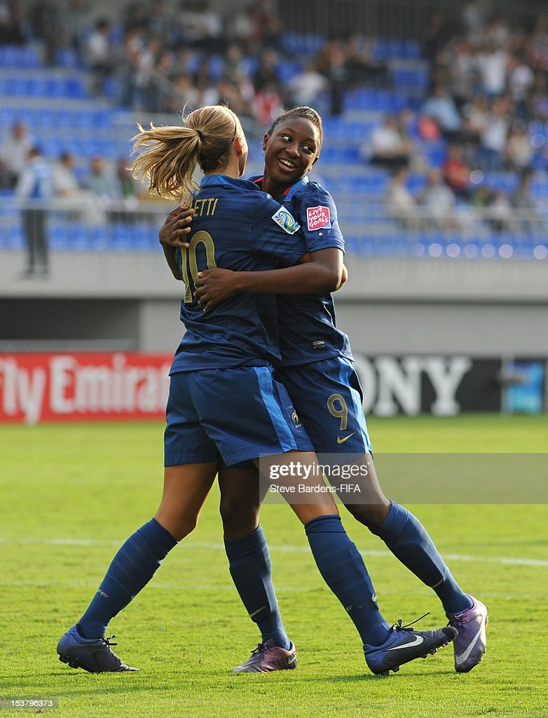 Diani Kadidiatou of France celebrates scoring a goal with Sandie Toletti during the FIFA U-17 Women's World Cup 2012 Semi-Final match between France and Ghana at 8KM Stadium on October 9, 2012 in Baku, Azerbaijan.