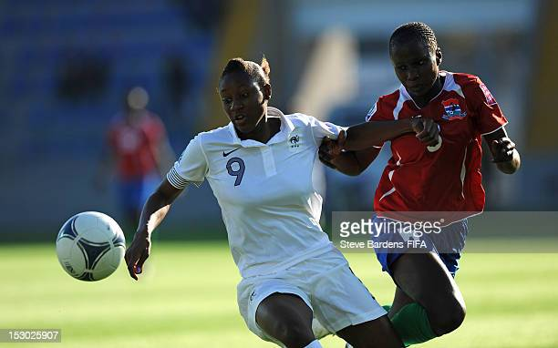 Diani Kadidiatou of France challenges for the ball with Binta Colley of Gambia during the FIFA U17 Women's World Cup 2012 group B match between...