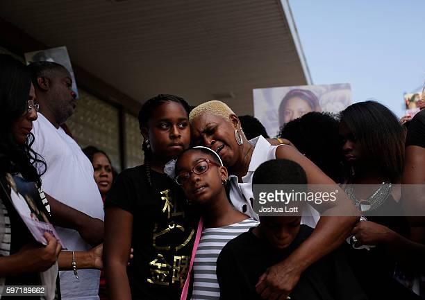 Diann Aldridge center the mother of Nykea Aldridge get emotional as she holds her grandchildren Summer Aldridge Shave Lenord and Sincere Simmons...
