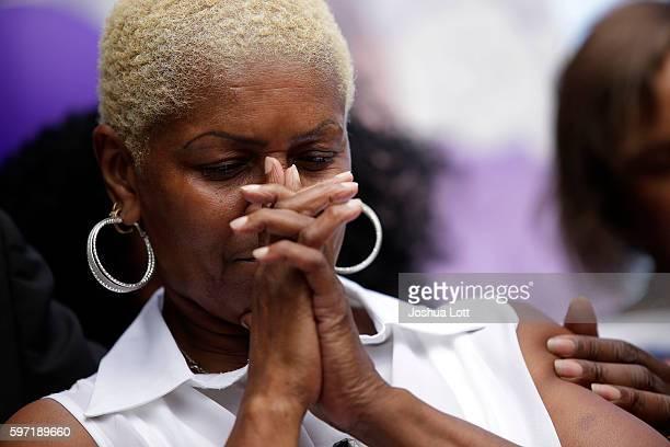 Diann Aldridge the mother of Nykea Aldridge bows her head during a prayer vigil for her daughter outside Willie Mae Morris Empowerment Center on...