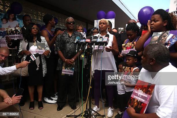 Diann Aldridge the mother of Nykea Aldridge center speaks to reporters during a prayer vigil for her daughter outside Willie Mae Morris Empowerment...