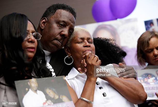 Diann Aldridge the mother of Nykea Aldridge is counseled during a prayer vigil for her daughter outside Willie Mae Morris Empowerment Center on...
