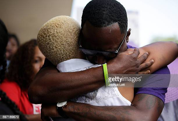 Diann Aldridge the mother of Nykea Aldridge is embraced with a hug during a prayer vigil for her daughter outside Willie Mae Morris Empowerment...