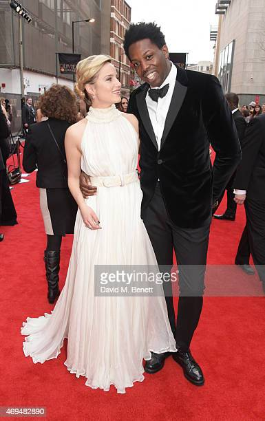 Dianna Agron and Adrien Sauvage attend The Olivier Awards at The Royal Opera House on April 12 2015 in London England