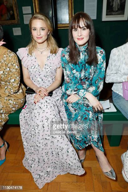 Dianna Agron and Michelle Dockery attend the Erdem show during London Fashion Week February 2019 at National Portrait Gallery on February 18 2019 in...