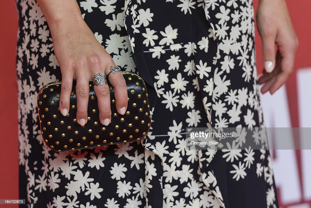 Dianna Agron (detail) attends the 'Malavita' premiere at Kino in der Kulturbrauerei on October 15, 2013 in Berlin, Germany.