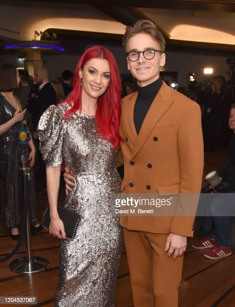 Dianne Buswell and Joe Sugg attend The WhatsOnStage Awards 2020 at The Prince of Wales Theatre on March 1 2020 in London England