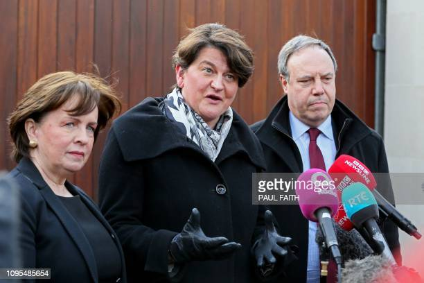 DUP MEP Dianne Dodds Democratic Unionist Party leader Arlene Foster and Deputy Leader of the DUP Nigel Dodds speak to members of the media in Belfast...