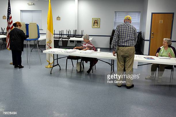 Dianne Hill and Allen Lee vote for Presidential nominee on Super Tuesday as Marjorie Kelly and Lynda Elliott in Mary's Hall at St. Anne's Catholic...
