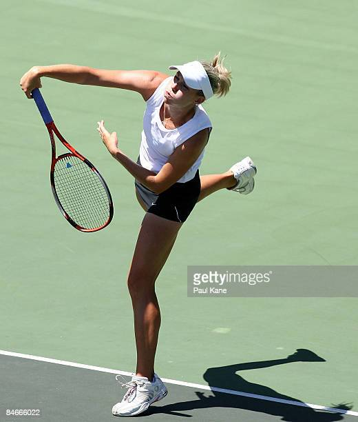 Dianne Hollands of New Zealand serves to Ayu Fani Damayanti of Indonesia during day three of the Fed Cup Asia/Oceania Zone Group 1 2 match between...