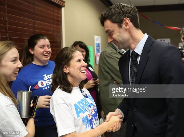 Dianne Kaufman shakes hands with Democratic candidate Jon Ossoff as he greets volunteers and supporters at a campaign office during an election day...