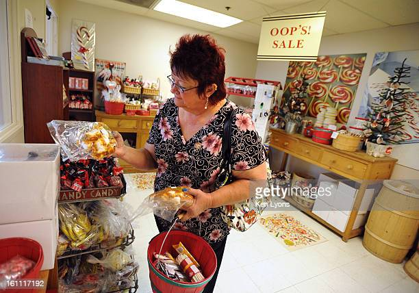 Dianne Ledebur, of California, looks through the Oop's Sale candy inside Hammond's. Hammond's Candy turns 90 this year, and they have an Oops Room at...