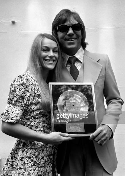 Dianne Lee and Lennie Peters with a gold disc presented to them for 500000 plus sales of their first charttopping single 'Welcome Home'