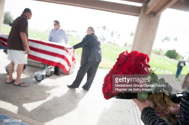 Dianne Reardon wife of friend John Campbell brings roses to the service of Phil Nealon a homeless man and longtime Laguna Beach native who died...