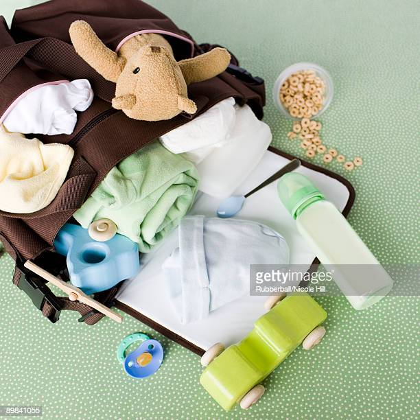 diaper bag spilled over - diaper bag stock pictures, royalty-free photos & images