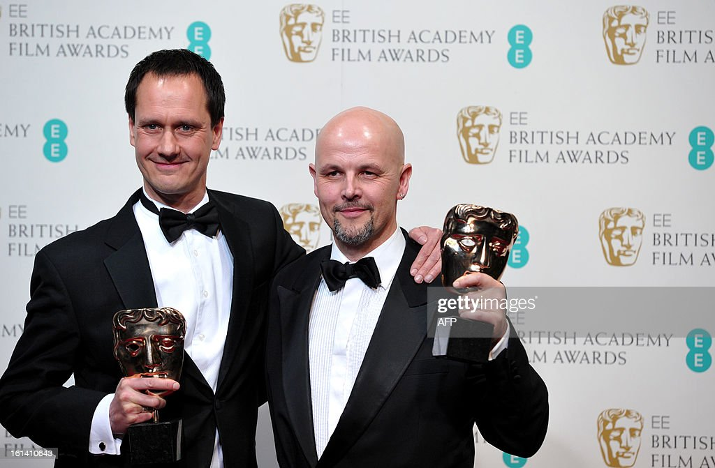 Diarmid Scrimshaw (L) and Peter Carlton, winners of the Short Film award for 'Swimmer', pose in the press roomduring the annual BAFTA British Academy Film Awards at the Royal Opera House in London on February 10, 2013. AFP PHOTO/Carl COURT
