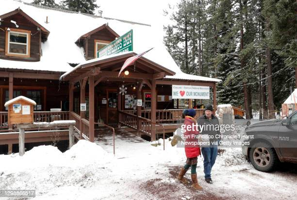 Diarmuid McGuire, owner of the Green Springs Inn and Cabins, right, talks with Erika Charbeneau after she picked up a package at the cafe in the...