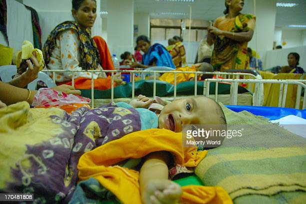 A Diarrhoea affected child on its sick bed at ICDDRB Hospital in Dhaka August 14 2007