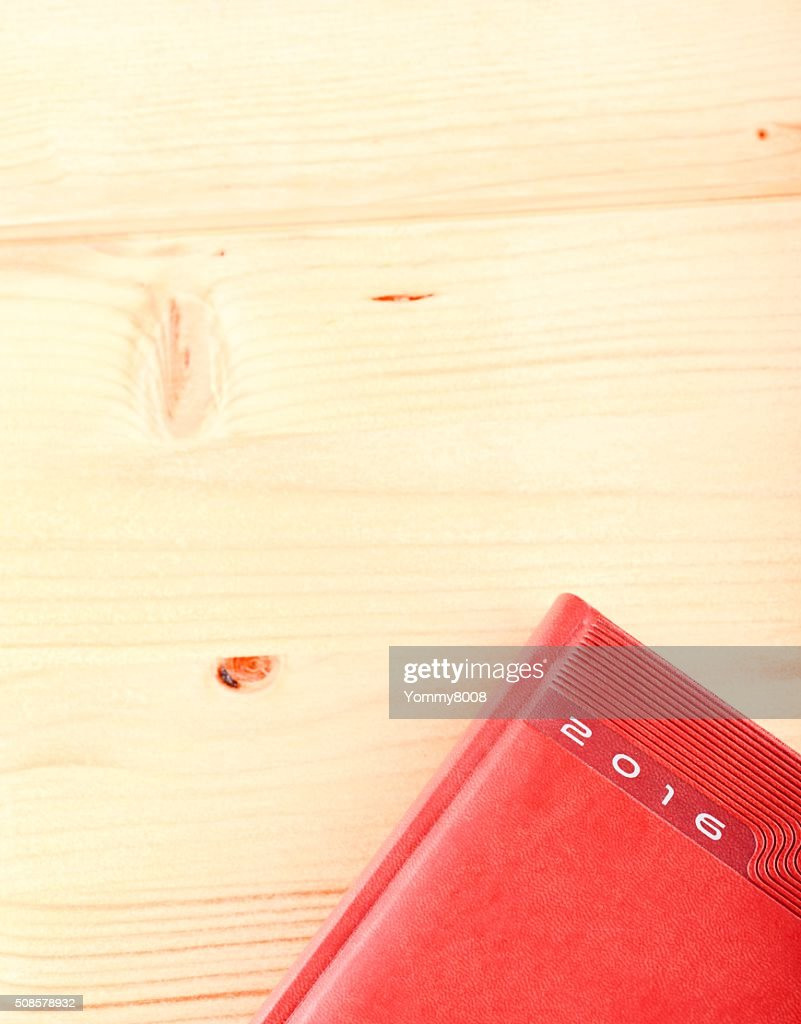 Diary 2016 on light wooden table : Stock Photo