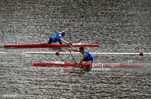 Dias Bakhraddin of Kazakhstan and Islomjon Abdusalomov of Uzbekistan competes in the Men - Canoe Head to Head Sprint Final during day 6 of Buenos...