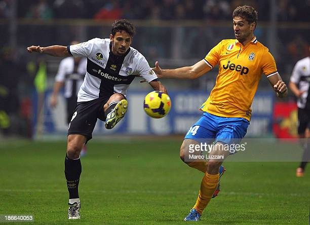 Dias Da Silva Dal Belo Felipe of Parma FC competes for the ball with Fernando Llorente of Juventus during the Serie A match between Parma FC and...