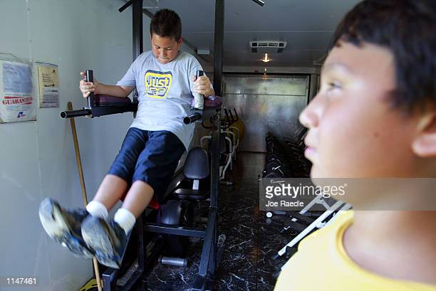 Diaz and Mike Echevarria workout in the Mobile Gym For Kids which specializes in training for overweight children July 22 2002 in Miami Florida...