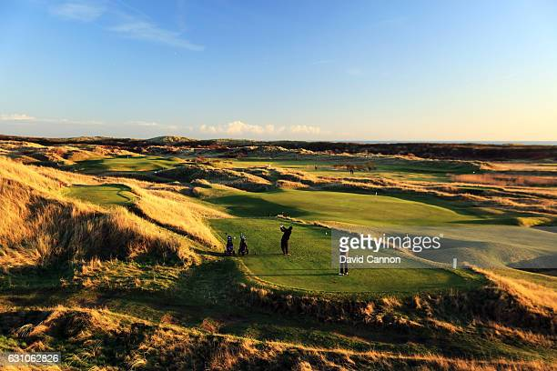 Dibran Zeqiri of Lincoln College Oxford and Andy Edmond of Trinity College Cambridge play off the seventh tee of The Old Course during the Oxford and...