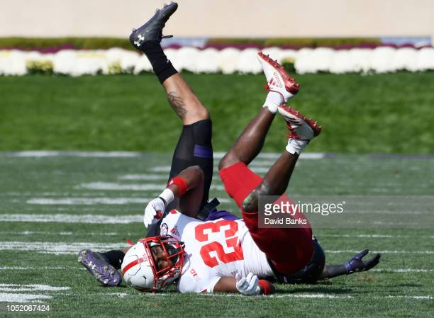 Dicaprio Bootle of the Nebraska Cornhuskers and wide receiver Ramaud ChiaokhiaoBowman of the Northwestern Wildcats get tangled up during the second...