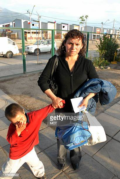 Dicciana victim of domestic violence picks up her son at day care October 3 2007 in Santiago Chile Almost 50 women in Chile have died at the hand of...