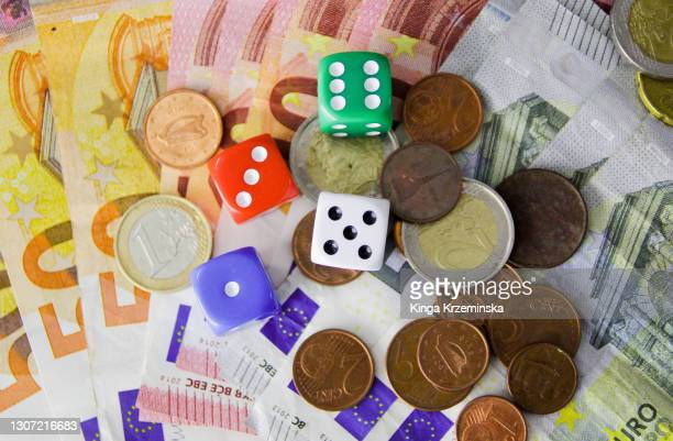 dice and money - bad luck stock pictures, royalty-free photos & images