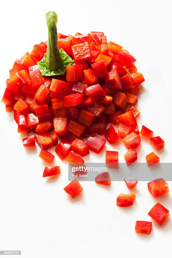 dice formed red  bell pepper forming : Stock Photo