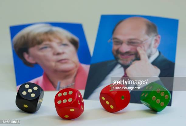 Dice game around Germany The symbol photo shows the portraits of Federal Chancellor Angela Merkel and her challenger at the forthcoming Bundestag...