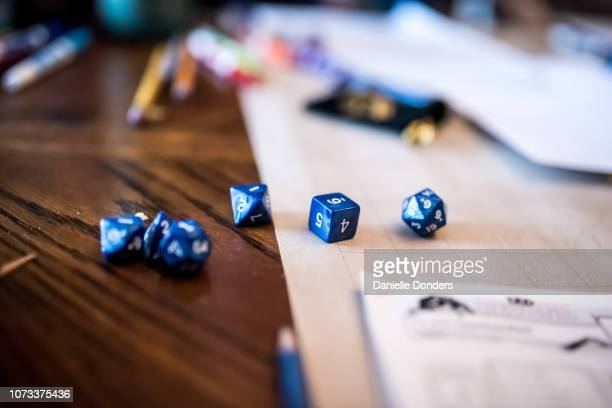 Dice, pencils and gameplay for dungeons and dragons role playing game