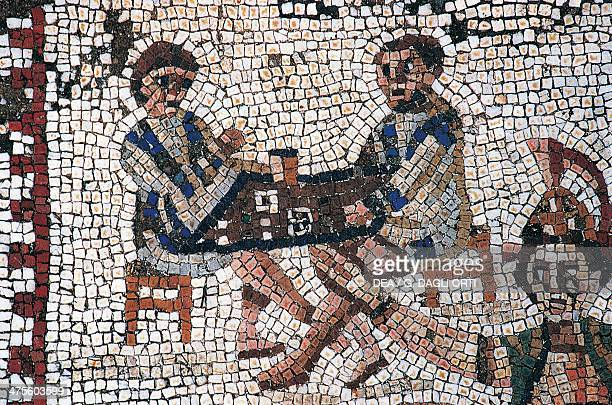 Dice players detail of a mosaic from a Roman villa near the Odeon Archaeological Site of Carthage Tunisia