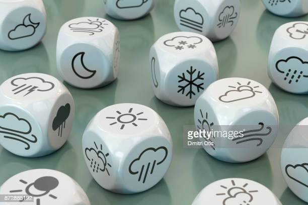 dice with weather symbols - meteorology stock pictures, royalty-free photos & images