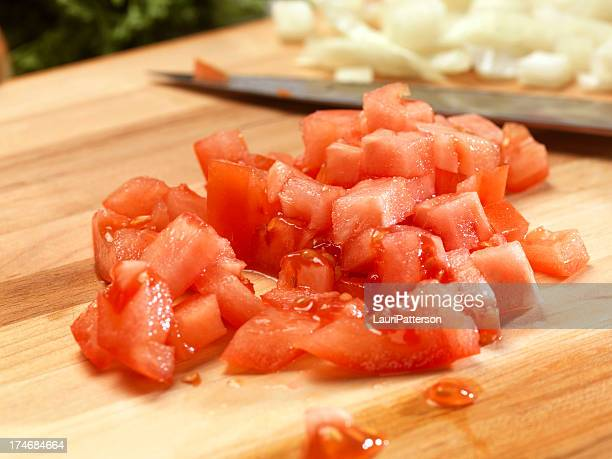 Diced Tomatoes on Cutting Board