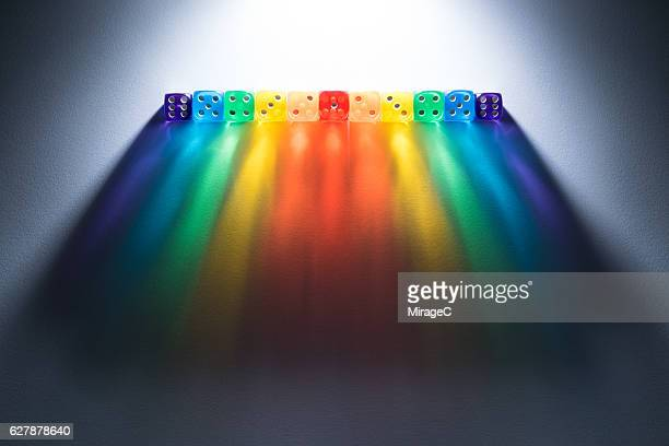 Dices with Long Rainbow Shadow