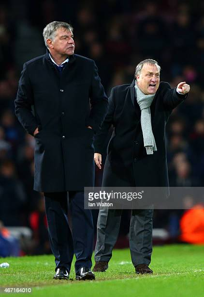 Dick Advocaat manager of Sunderland issues instructions to his players next to Sam Allardyce the West Ham manager during the Barclays Premier League...
