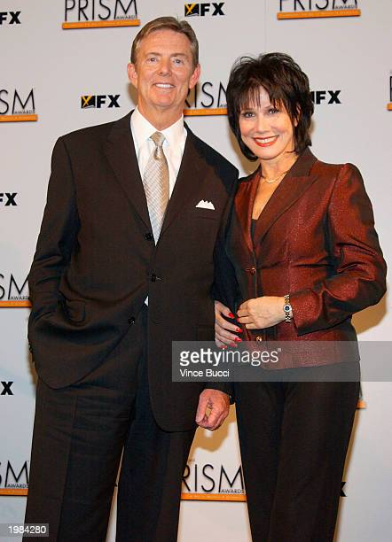 Dick Askin President and CEO of Tribune Entertainment and actress Michelle Lee pose backstage at the 7th Annual Prism Awards held at the Henry Fonda...
