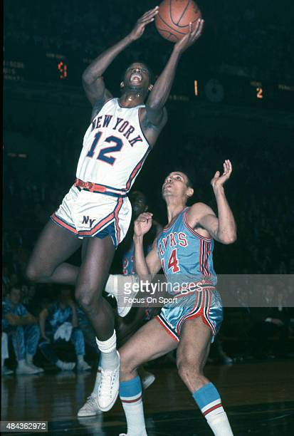 Dick Barnett of the New York Knicks shoots over Lenny Wilkens of the St Louis Hawks during an NBA basketball game circa 1967 at Madison Square Garden...