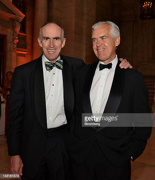 Dick Cashin managing partner at One Equity Partners LLC left and attendee Philip Howard stand for a photograph at the Municipal Art Society Gala in...